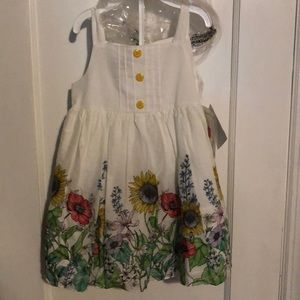 Adorable baby girl floral dress with sunflowers